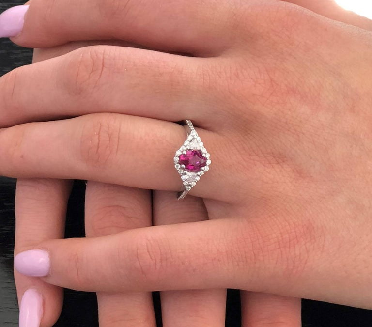18 karat white gold ruby and diamond cocktail ring  Diamond carat weight 0.64  Trillion diamond carat weight 0.20  Ruby carat total weight 1.02 Ring finger size 6.5  Diamond quality G VS New ring  Ring can be resized   Our team of graduate