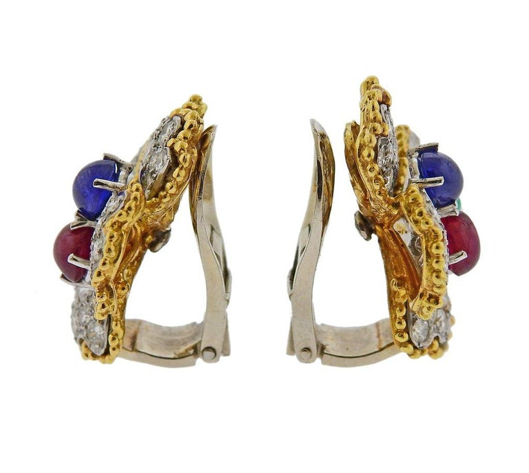 Pair of 18k gold and platinum Mid Century flower earrings, set wtih approx. 2.60ctw in FG/VS-SI1 diamonds, ruby, emerald and sapphire gemstones. Earrings are 25mm x 25mm. Weight is 18.2 grams. Marked PAT. Tested 18k/Plat.