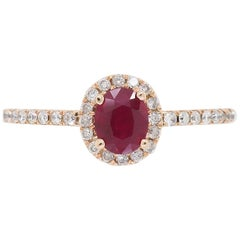 Ruby and Diamond Halo Ring in Rose Gold