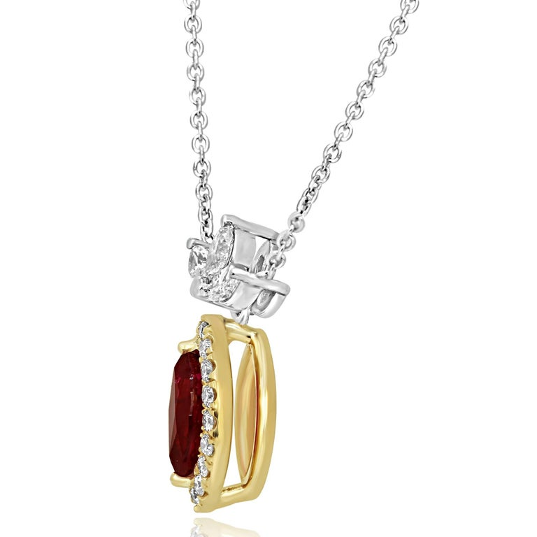 Stunning Ruby Marquise 0.86 Carat encircled in a single Halo of white round diamonds 0.22 carat with 3 White Diamond Marquise 0.22 Carat on top in 18K White and Yellow Gold Necklace. Matching Ear Ring Sold Separately on 1stdibs.  MADE IN USA Total