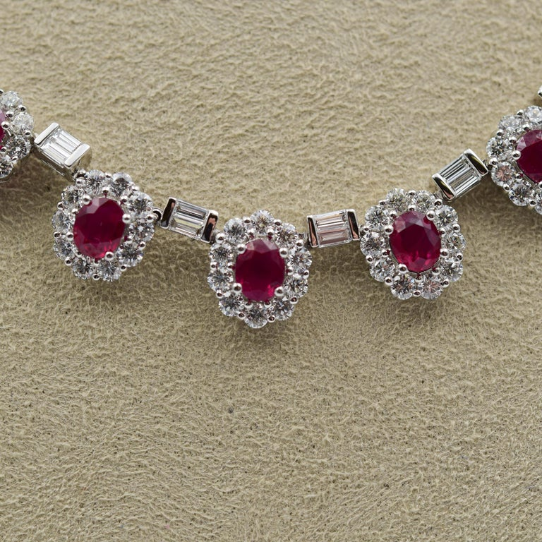 This immaculate ruby and diamond necklace was recently sold to the store as an estate piece.  The rubies are all a very fine red similar to a Burmese red ruby and each one has a diamond-set halo accenting the stone.  Between each of the halo