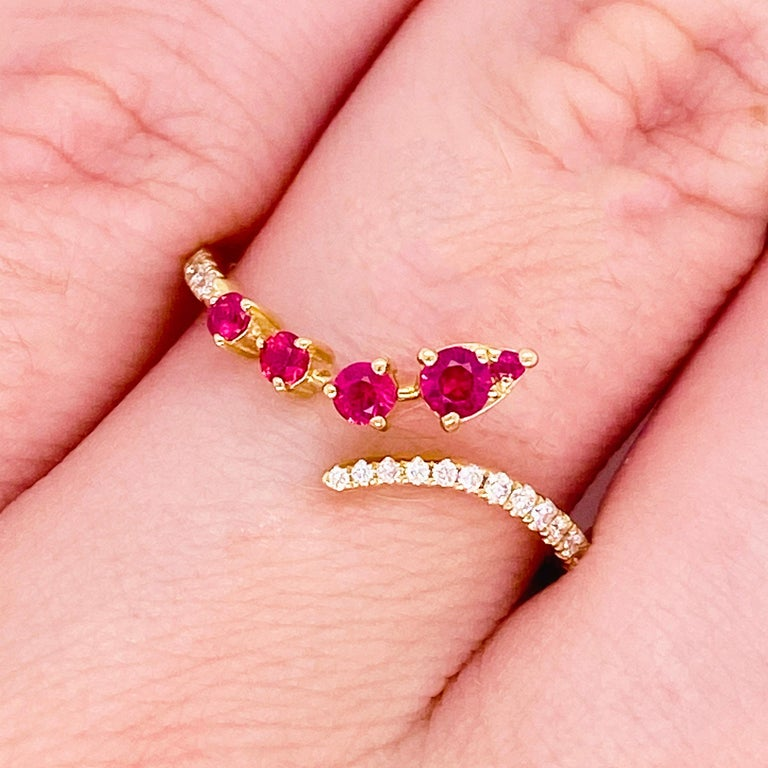 These stunning red rubies and gorgeous diamonds surrounded by polished 14k yellow gold provide a look that is very modern! This ring is very fashionable and can add a touch of style to any outfit, yet it is also classy enough to pair easily with