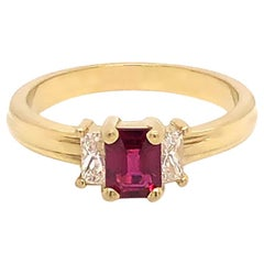 Ruby and Diamond Three-Stone Ring in 18 Karat Yellow Gold