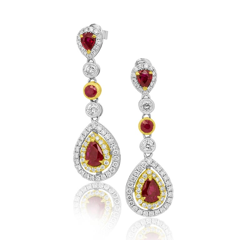 2 Pear shape Ruby 1.85 Carat encircled in double halo of White Diamonds 1.90 carat with 2 Ruby Rounds 0.44 Carat in Bezel setting and 2 Ruby Pear shape 0.76 Carat encircled in single halo of white diamonds.   Diamonds total weight 1.90 Carat
