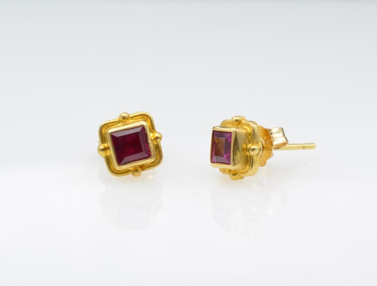 These delicate ruby beauties are vibrant deep red accented by 18k yellow gold for the perfect balance.  The delicate beaded bezel adds dimension. You can wear these every day as they are so pretty!