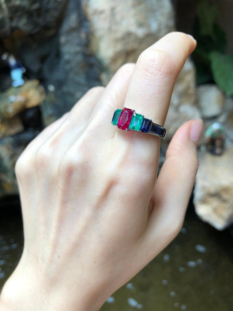 Emerald Cut Ruby, Emerald and Blue Sapphire Ring Set in 18 Karat White Gold Settings For Sale