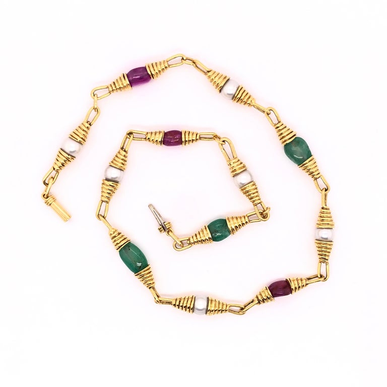 This versatile and unique necklace can be worn with your favorite pair of jeans or dress. The estimated 9.25 CTW of rubies, estimated 10 CTW of emeralds and six 7mm pearls are a sure conversation starter. At 17 inches the necklace rests nicely on