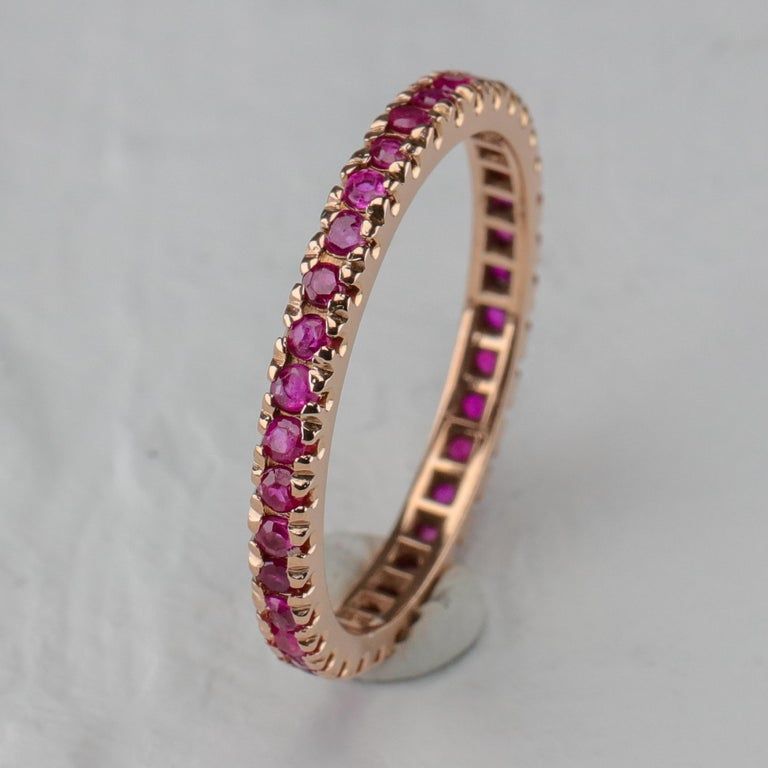 Because I collect rare or one-of-a-kind jewels, this does seem like a rather odd piece for me to be offering. A ruby eternity band? That's not exactly rare. A size ten ruby eternity band? Hello, rare.  This circa 1940s Retro-era ring is composed of