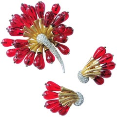 Ruby glass and paste 'sunburst' flower head brooch and earrings, Boucher, 1960s