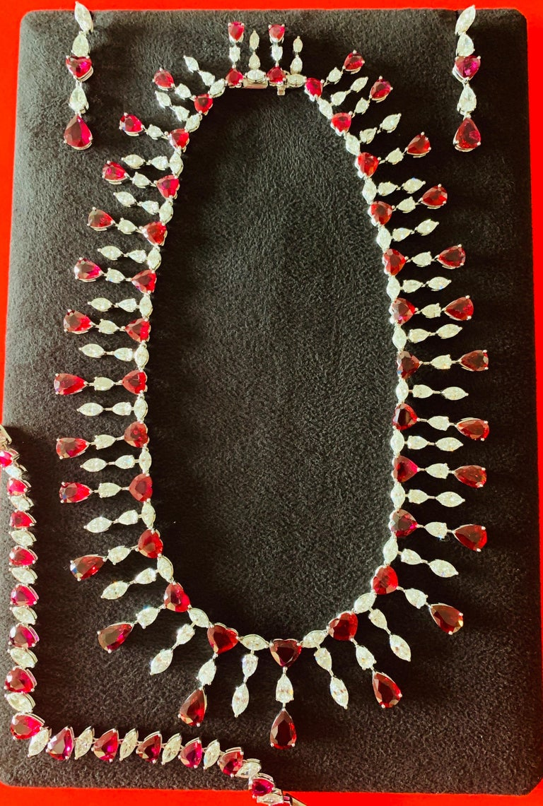 Exceptional beauty and exquisite elegance. This ruby ( no heat ) and diamond necklace includes a pair of earrings and a bracelet. The details are as follows ;  Heart shape and Pear shape ruby weight : 125 carat / 74 stones ( no heat rubies) Marquise