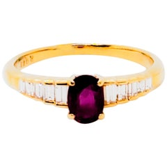 Ruby Oval and White Diamond Ring in 18 Karat Yellow Gold