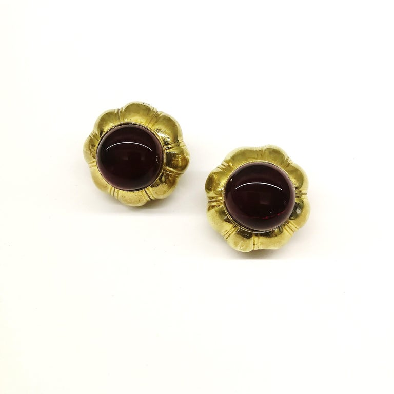 Classic and highly wearable, these beautiful early Chanel ruby poured glass and gilt earrings, made by Maison Goossens, Chanel's celebrated collaborator and facilitator, radiate inherent style and quality for any wearer or collector. Not much needs