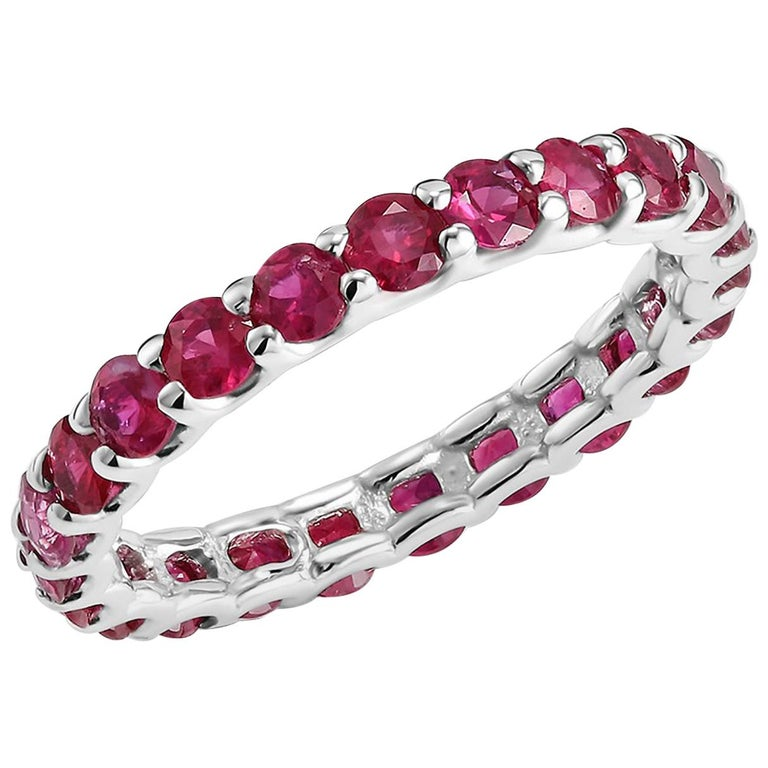Fourteen karat white gold eternity wedding or stacking band  Basket Prong Set Setting Diamond Cut Burma ruby weighing 2.30 carat  Stone Size 2.75 millimeter New ring .  Ring size 6.25 In Stock Ring cannot be resized  Handmade in USA Our team of