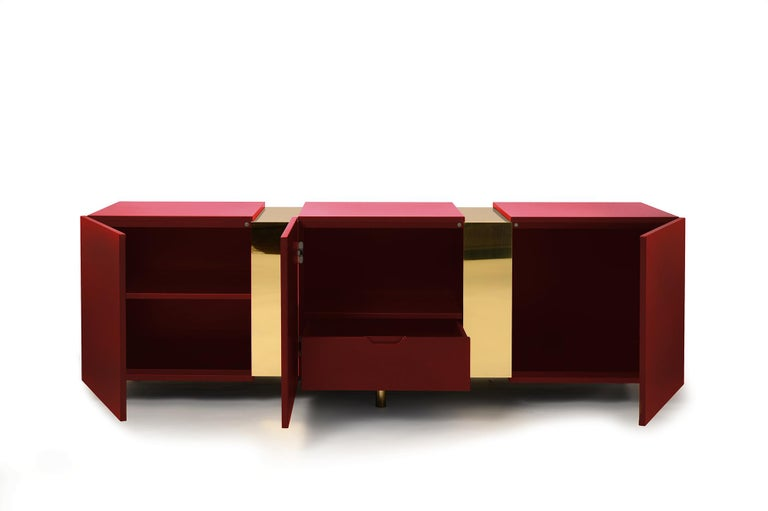Eunduetrè is a low storage system which punctuates the space and plays with contrasting effects. Extremely simple in its geometric shapes, this sideboard/credenza alternates colorful cubes in matte lacquered wood, with sections of bent brass sheet