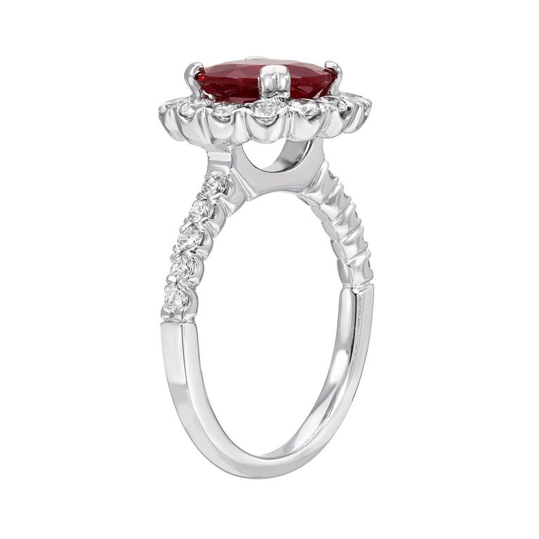 Classic intense-red Ruby round, weighing a total of 2.53 carats, is adorned by a total of 0.78 round brilliant diamonds in this 18K white gold engagement ring or cocktail ring.  The C. Dunaigre gem certificate is attached to the images for your