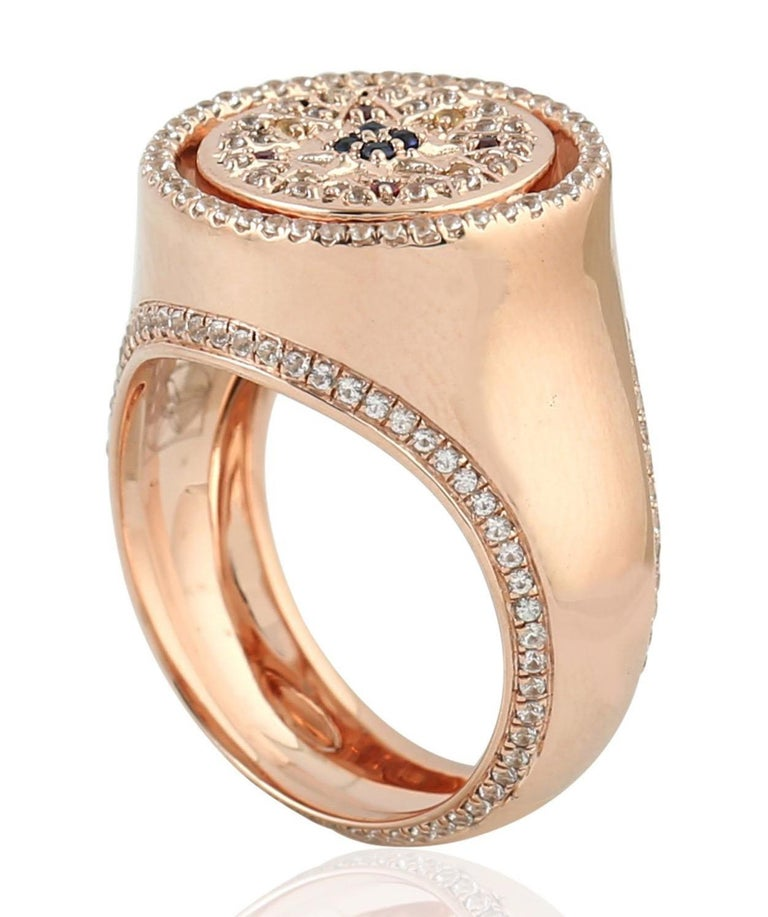 This ring has been meticulously crafted from 9-karat rose gold. It is set in .86 carats sapphire and .03 carat ruby. Also available in yellow gold.  The ring is a size 7 and may be resized to larger or smaller upon request.  FOLLOW  MEGHNA JEWELS