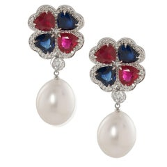 Goshwara Ruby and Sapphire Heart Shape Flower Earrings with Pearls