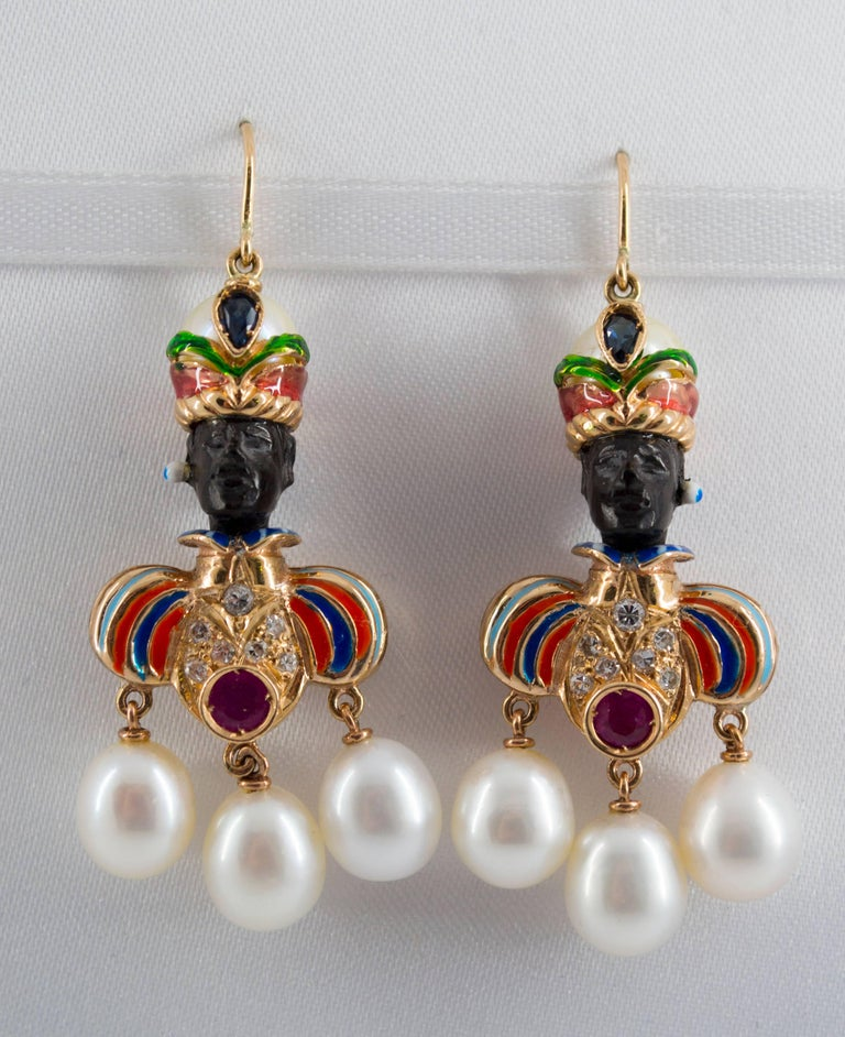 These earrings are completely handmade in Naples with ebony, yellow 14K gold and enamel using the antique techniques of Venetian jewellery.  There are also 1.0 Carat of rubies and sapphires, cultured pearls and 0.20 Carats of Diamonds. We're a