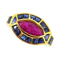 Ruby with Blue Sapphire Ring Set in 18 Karat Gold Settings