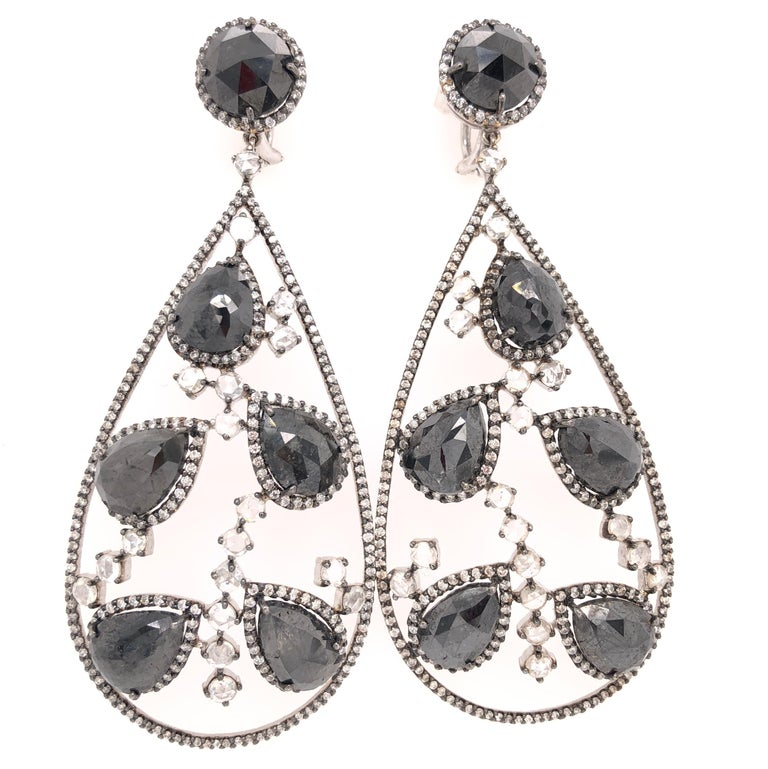 Organic Forms Collection  Pear shape black Diamonds and rose cute white Diamonds chandelier earrings set in 18K black rhodium gold and white gold.   Black Diamonds: 34.48ct total weight. Diamonds: 6.53ct total weight. All diamonds are G-H/SI