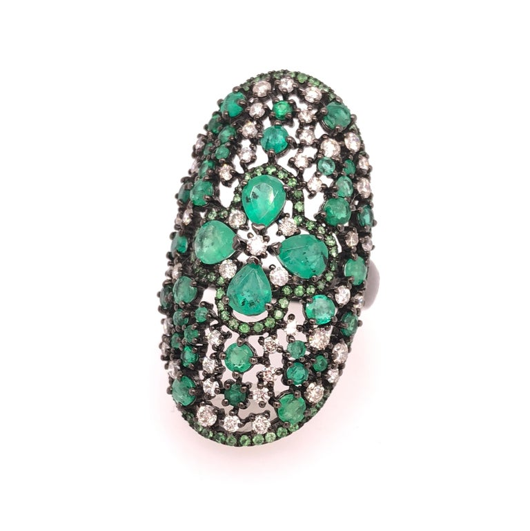 Green Lagoon Collection  Emerald and Diamond cocktail ring with thin green Garnet pavé set in 18K black rhodium gold.   Emerald: 2.76ct total weight. Diamonds: 0.92ct total weight. Green Garnet: 0.53ct total weight.  All diamonds are G-H/SI