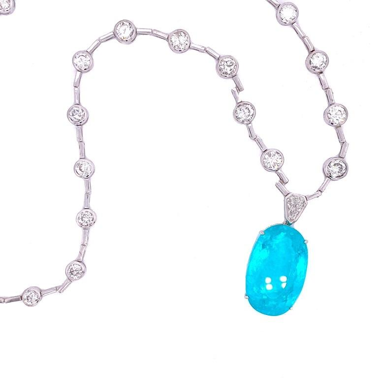 Exclusive Collection   Impressively large and bright Paraiba Tourmaline and Diamond statement necklace set in 18K white gold. Pendant is removable for ultimate versatility. Diamond chain 20 inches, and the Paraiba Tourmaline is 1 inch long and just
