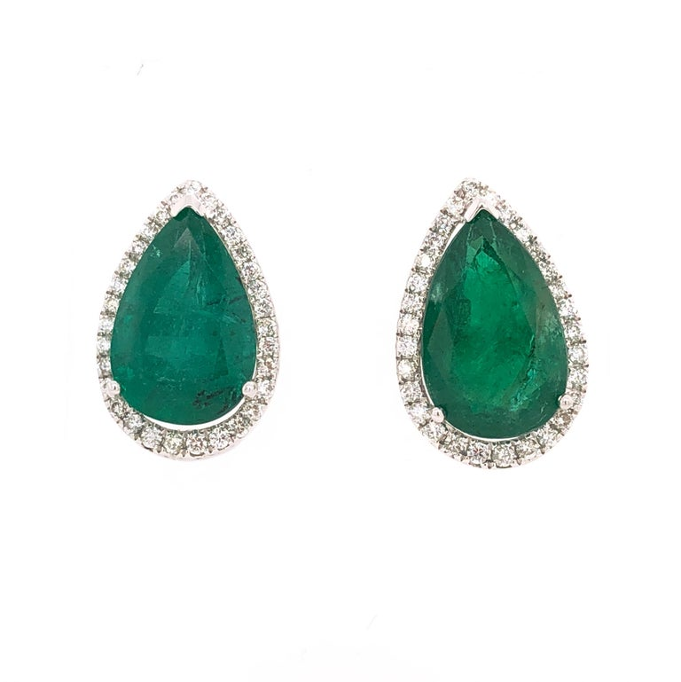 Green Lagoon Collection   Everyday pear shape Emerald stud earrings with pavé diamonds set in 18K white gold.   Emerald: 7.89ct total weight. Diamonds: 0.65ct total weight. All diamonds are G-H/SI stones. Height - is approximately