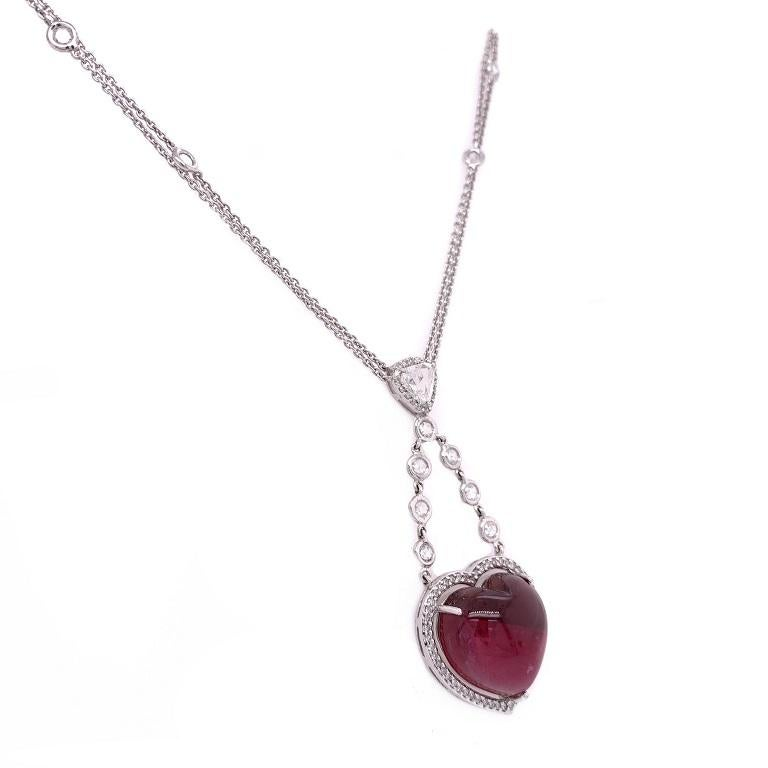 Exclusive Collection  Enchanting rich pink Tourmaline heart cabochon with Diamond halo and double rose cut Diamond by the yard chain. Set in 18K white gold.   Pink Tourmaline: 17.95ct total weight. Diamonds: 1.73ct total weight. All diamonds are