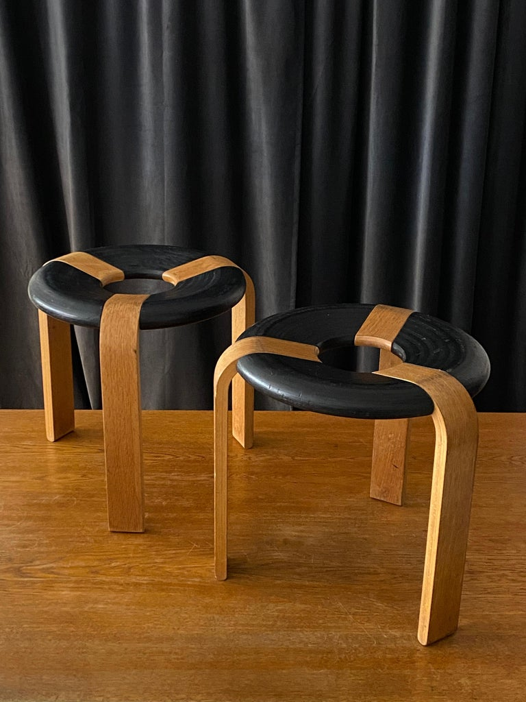A pair of early production all original oak stools by Rud Thygesen and Johnny Sorensen. For Magnus Olsen, Denmark, designed in 1971. With excellent original patina. Stackable