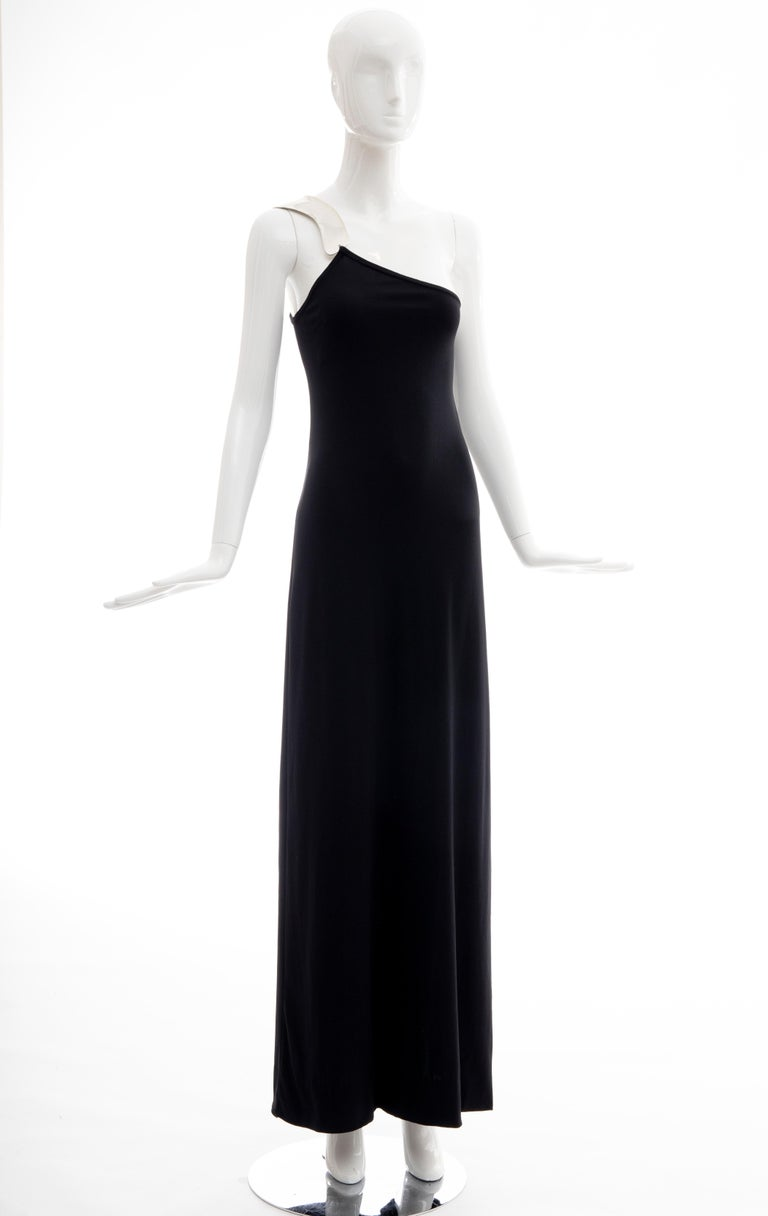 Rudi Gernreich for Bob Cunningham, Spring 1975, black matte jersey evening dress with signed sculpted aluminum shoulder piece by jewelry designer Christopher Den Blaker, side slit and back zip and hook-and-eye closure.  As documented on Peggy Moffat