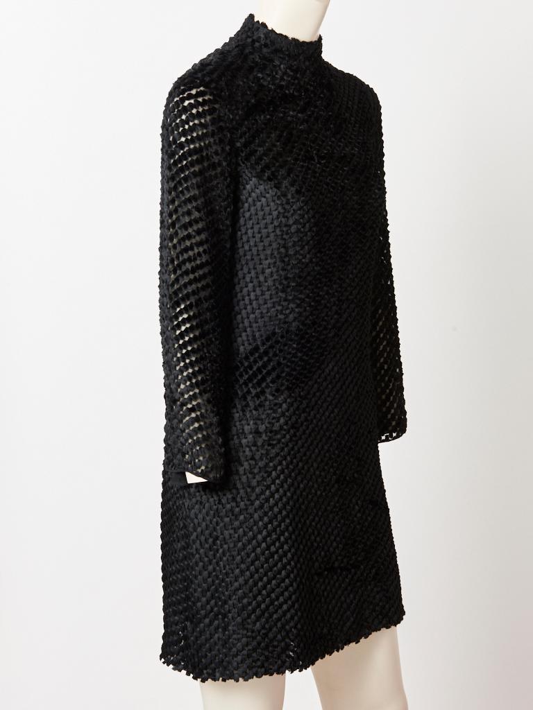 Rudi Gernreich, black, geometric pattern, cut velvet, long sleeve mini dress having a mock turtle neck, A line shape and middle back, zippered closure.