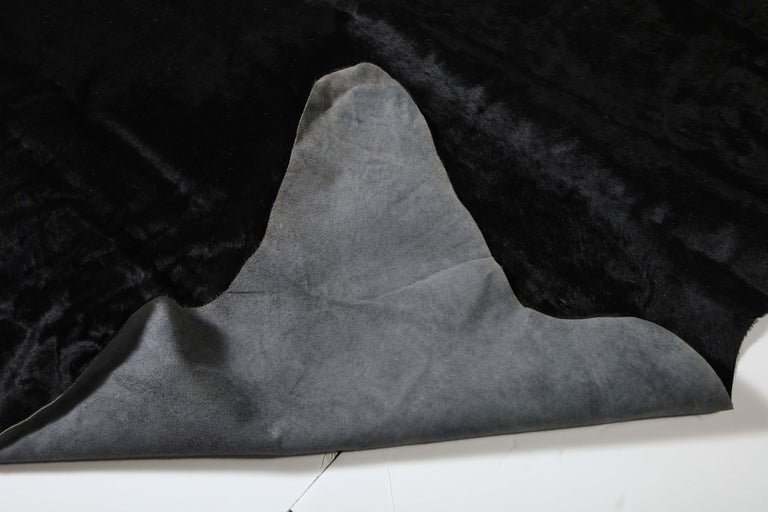 Rug, Cow Hide, Black In Fair Condition For Sale In New York, NY