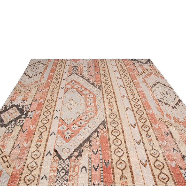 Hand knotted in high-quality wool originating from India, this geometric-floral rug is the latest addition to Rug & Kilim's Homage Collection, enjoying a finer take on distressed shabby chic aesthetic with fewer knots per square inch. One of the