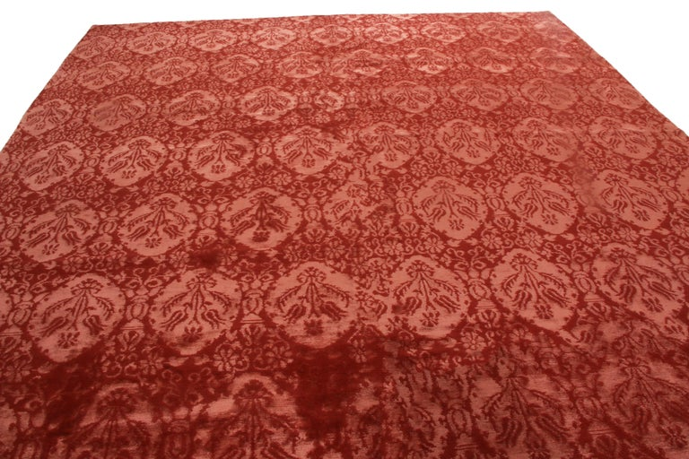 Originating from Nepal, this contemporary wool and silk rug features a finely drawn all-over Medici design in a rich, luminous crimson red. handwoven in intricate New Zealand wool and Chinese silk, the field's natural shimmer plays a sort of trick