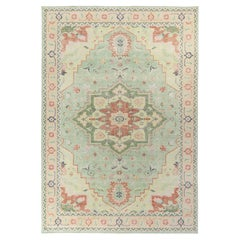 Rug & Kilim's Distressed Serapi Style Rug in Green, Red Medallion Pattern