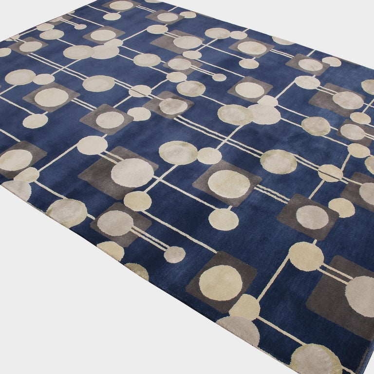 Made in hand knotted wool, natural silk and exotic yarns unique to our team, this geometric rug joins the latest additions to Rug & Kilim's Mid-Century Modern Collection, a bold custom-capable line recapturing an underrepresented, iconic period with