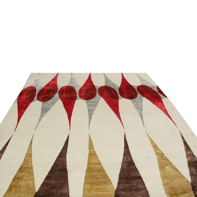 Hand knotted with quality semi-worsted wool, natural silk and exotic yarns, this geometric rug is among the latest additions to Rug & Kilim's Mid-Century Modern Collection, a custom-capable line recapturing an underrepresented, iconic period with an