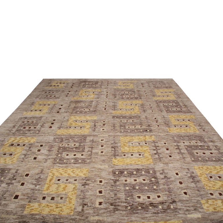 Rug & Kilim's hand knotted Swedish style rug hails from the latest wool pile additions to the Scandinavian collection, a celebration of geometric minimalism and elemental colorways like that of their midcentury inspirations. The mixed pile height of