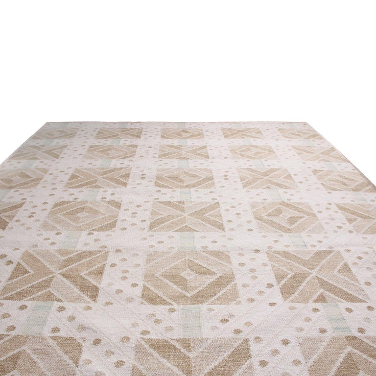 Rug & Kilim's handwoven Swedish-style rug hails from the latest natural wool flat-weave additions to the Scandinavian Collection, offering our unique, refined large-scale approach to the geometry and vintage colorways like that of their mid-century
