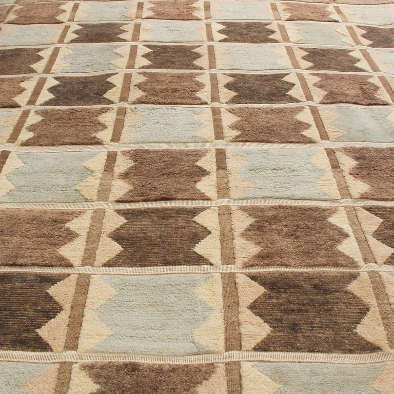 Originating from India, this hand knotted contemporary pile rug hails from Rug & Kilim's Scandinavian-inspired collection, featuring a distinct patchwork all-over field design with bold black, off-white, gray, and multi-tonal blue colorways.