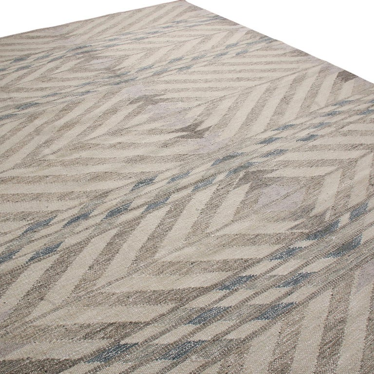 Rug & Kilim's hand-woven Swedish-style rug hails from the latest wool flat weave additions to the Scandinavian Collection, offering our unique, refined large-scale approach to the geometry and vintage colorways like that of their mid-century