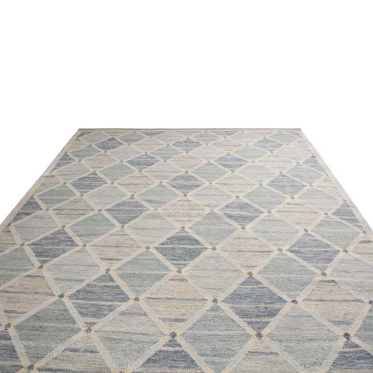Rug & Kilim's hand woven Swedish-style rug hails from the latest wool flat weave additions to the Scandinavian collection, a celebration of large-scale geometry and exciting vintage colorways like that of their mid-century inspirations. The abrashed