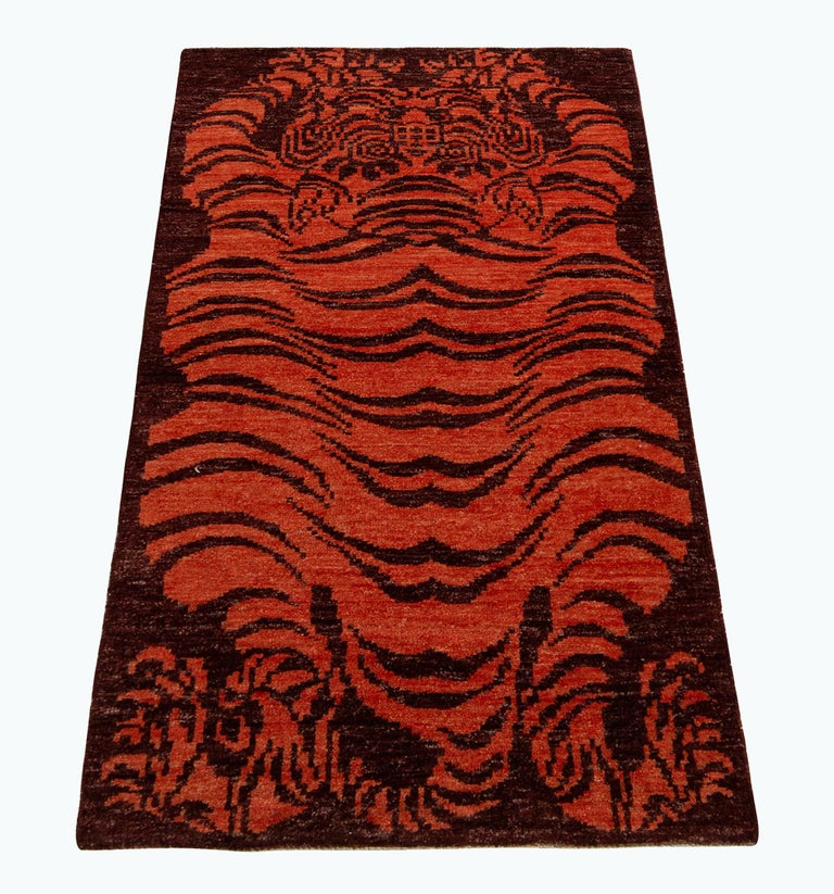 A 3x6 runner inspired by classic Tibetan Tiger rug styles, from the titular new collection by Rug & Kilim. Hand knotted in wool, enjoying rich, abrashed hues of orange against burgundy in a fierce and warm, curvaceous style. Exemplative in its