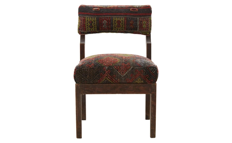 Made in America in the 20th century, our Vintage rug chair is in excellent condition for its age. It features its original, lightly weathered carved wood frame, paired with plush seat and back cushions reupholstered with a textural,