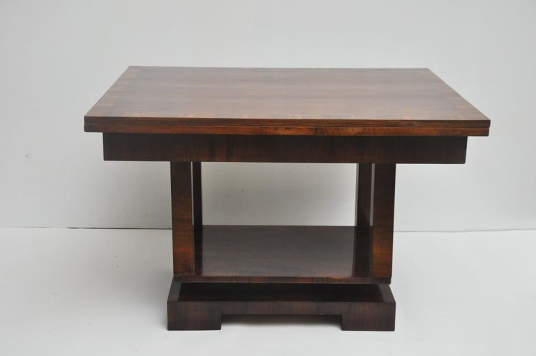 This Deco style extension table opens to 87.5