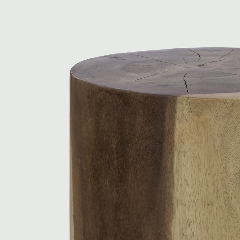 Deftly crafted from a single trunk of top-rate, solid acacia this exclusive coffee table strikes with its spontaneous, rustic-chic allure. The cylindrical body is distinguished by a precious finish, minutely executed by hand, that enhances the
