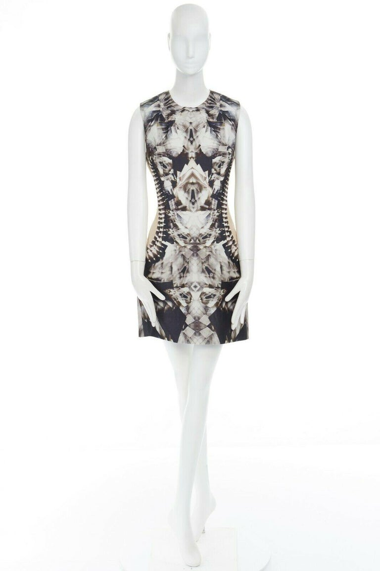 ALEXANDER MCQUEEN  FROM THE SPRING SUMMER 2009 RUNWAY BLACK WHITE DIAMOND KALEIDOSCOPE DIGITAL PRINT • ILLUSION OF A CRYSTALIZED SPINE DOWN CENTER BACK • SLEEVELESS DRESS • NUDE DOUBLE LAYERED CHIFFON CUT OUT ILLUSION PANELS ON SIDE • FULLY LINED •