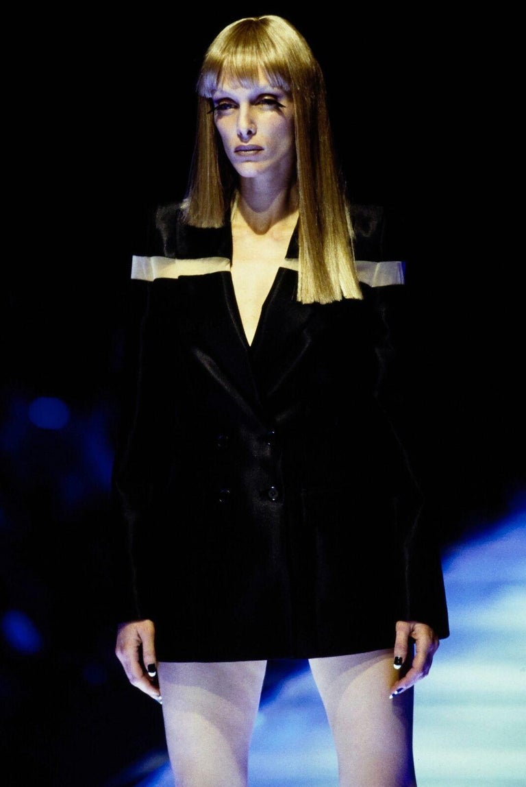 ALEXANDER MCQUEEN From the Spring Summer 1998 'Golden Shower' Collection Rare set completed with matching pinstripe trousers and blazer. Worn as a mini dress on runway. Jacket: Wool, polyester, nylon, elastic. Black base with yellow pinstripe.
