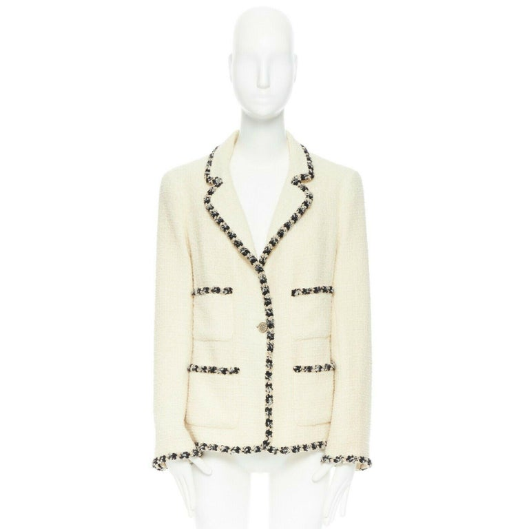 runway CHANEL 06A cream tweed black trim lapel 4 pocket school boy jacket FR46 Brand: CHANEL Designer: Karl Lagerfeld Collection: 06A Model Name / Style: Tweed jacket Material: Wool blend Color: Ecru Pattern: Solid Closure: Button Lining material: