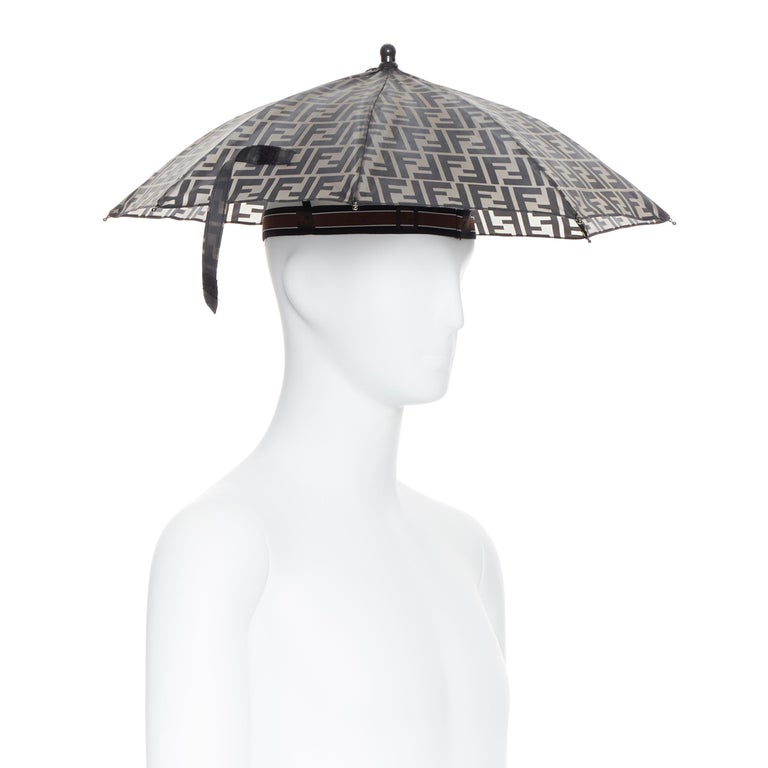 runway FENDI grey FF logo mongram print rubber forever umbrella hat rare Brand: Fendi Model Name / Style: Umbrella hat Material: Rubber Color: Grey Pattern: Abstract Closure: Pull on Made in: Italy  CONDITION:  Condition: New without tags. Comes